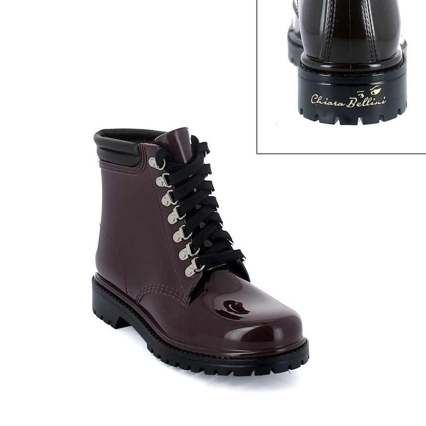 Short laced up walking boot in Sanguinaccio pvc with leatherette padded trim. New 3D logo.